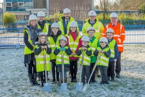 Pupils and officials gather to mark the start of work on new nursery