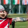 Nathan MacQueen preparing to fire his bow