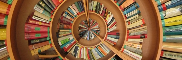 Colourful bookcase in spiral pattern
